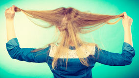 Blonde woman playing with hair. Royalty Free Stock Images