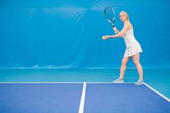 Blonde Woman Playing Tennis royalty free stock photos