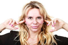 Blonde woman plug ears Royalty Free Stock Photos