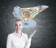 Blonde woman pointing at a startup idea sketch Stock Photography
