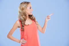 Blonde woman pointing to the right Stock Photo
