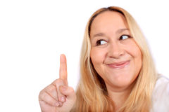 Blonde woman pointing up Royalty Free Stock Image