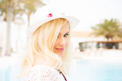 Blonde woman by the pool Stock Photography