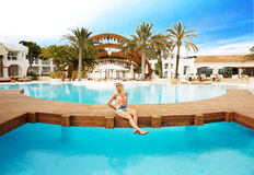 Blonde woman by the pool Royalty Free Stock Photos