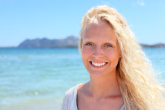 Blonde woman portrait outdoors on beach Royalty Free Stock Photos
