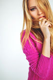 Blonde woman portrait in pink isolated background Stock Photography