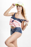 Blonde woman posing in American flag shirt Stock Photo