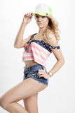 Blonde woman posing in American flag shirt Royalty Free Stock Photography