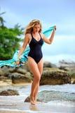 Blonde Woman Posing at the beach Stock Photos