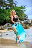 Blonde Woman Posing at the beach Royalty Free Stock Image