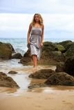 Blonde Woman Posing at the beach Royalty Free Stock Photography