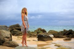 Blonde Woman Posing at the beach Stock Photography