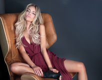 Blonde woman posing in dress. Royalty Free Stock Photos
