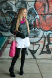 Blonde woman posing  of  grafitti Royalty Free Stock Image
