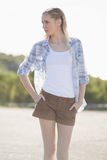 Blonde woman posing with hands in pockets Royalty Free Stock Image