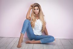 Blonde woman posing in jeans. Stock Images