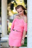 Blonde Woman Posing In Pink Dress Stock Photo
