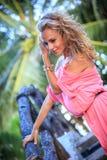 Blonde Woman Posing In Pink Dress Stock Image