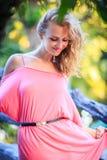 Blonde Woman Posing In Pink Dress Stock Photo