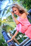 Blonde Woman Posing In Pink Dress Royalty Free Stock Photography