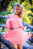 Blonde Woman Posing In Pink Dress Stock Images