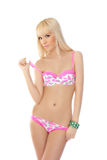 Blonde woman posing in pink lingerie Royalty Free Stock Photos