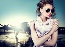 Blonde woman posing in sunglasses Stock Image