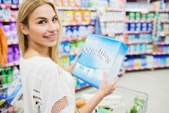 Blonde woman posing with washing powder Royalty Free Stock Photos