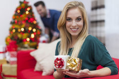 Blonde woman with presents Stock Photography
