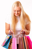 Blonde woman with purchases Royalty Free Stock Image