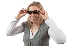 Blonde Woman Putting on Sunglasses Royalty Free Stock Image