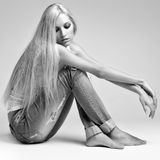 Blonde woman in ragged jeans and vest Stock Photos