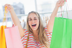 Blonde woman raising shopping bags Stock Image