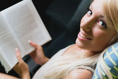 Blonde woman reading. A book Stock Photography