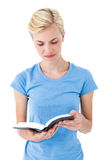 Blonde woman reading bible Royalty Free Stock Photos