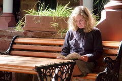 Blonde woman reading a book Royalty Free Stock Photo
