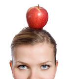 Blonde woman with a red apple on her head Royalty Free Stock Images