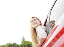 Blonde woman in red car Royalty Free Stock Image