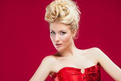 Blonde woman in red dress Royalty Free Stock Photography