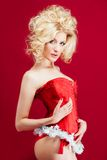 Blonde woman in red dress Stock Images