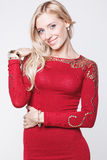 Blonde woman in red dress and bracelets Royalty Free Stock Photography