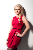 Blonde woman in red dress Royalty Free Stock Image