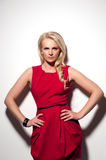 Blonde woman in red dress Royalty Free Stock Photos