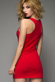 Blonde woman in red dress Stock Image