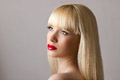 Blonde woman with red lips Stock Photo