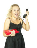 Blonde woman  with a red retro phone Royalty Free Stock Images