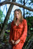 Blonde Woman in Red Wet Dress at rainig day Royalty Free Stock Photo
