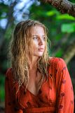 Blonde Woman in Red Wet Dress at rainig day Royalty Free Stock Photos
