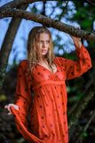 Blonde Woman in Red Wet Dress at rainig day Royalty Free Stock Photography