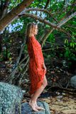 Blonde Woman in Red Wet Dress at rainig day Royalty Free Stock Image